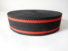 Secondary color aramid fiber webbing for fire safety