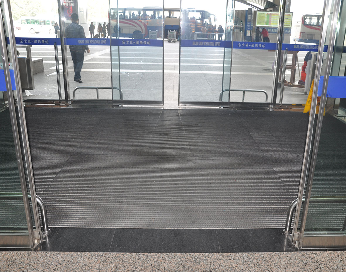 What is the recommended size for an entrance matting system?