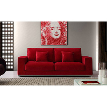 Red upholstered velvet fabric covered corner sofa