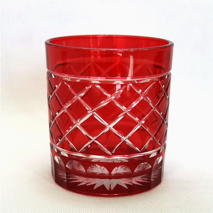 horn shape embossed black and red glass candle jar