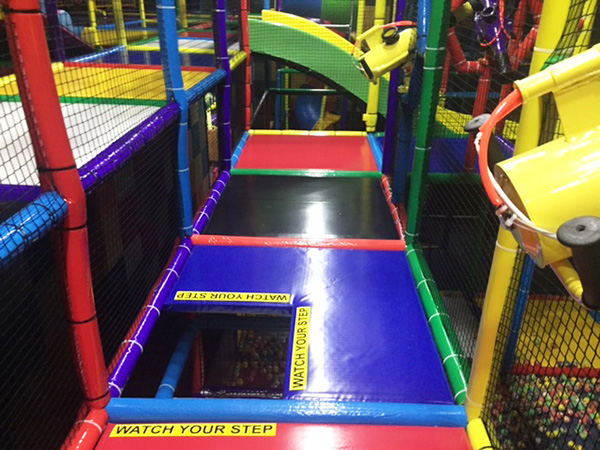 Why are the safety standards for indoor playgrounds important?