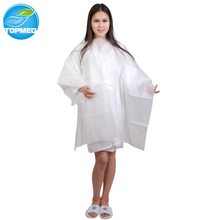 Disposable non-woven hair cutting cape with velcro